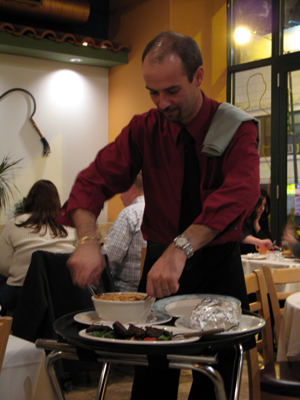 Serving up table-side at Venus Greek-Cypriot Cuisine.