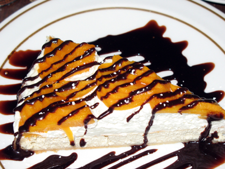 Mystery fruit tart with chocolate sauce.