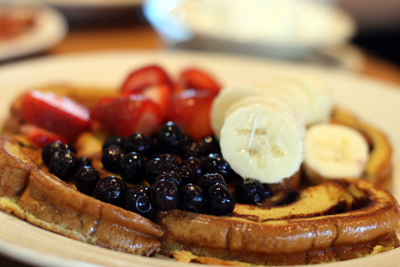 Lumes serves a generous portion of fruit with its French toast.