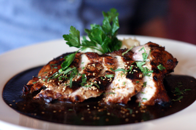 Mixteco Grill's pork chop in an excellent Oaxaca mole sauce.