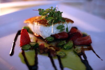 Fava beans and strawberries make the Alaskan halibut a standout dish at Tallulah.