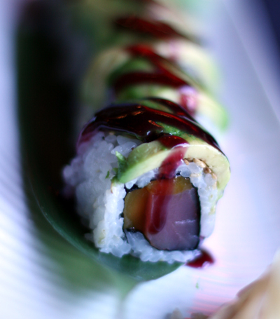 The tropical mango Maki is topped with a grape jelly-like sauce.