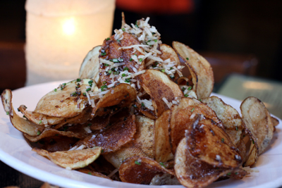 The tavern potato chips are drizzled with truffle oil, splashed with balsamic vinegar, loaded with evil, and oh so good.