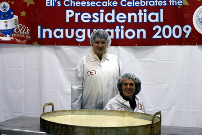 During our factory tour, Tammy and I pose near a layer of the 500-pound inaugural cheesecake that Eli's baked for the Commander-in-Chief Ball, held in Washington DC on January 20.