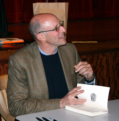 Michael Pollan graciously signed books for the capacity crowd.