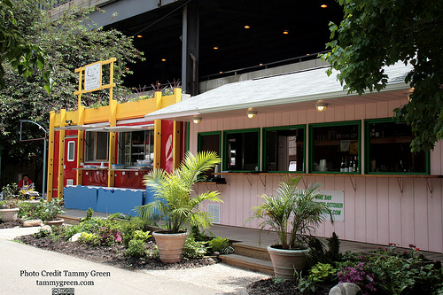 Cyrano's Cafe sits in a sunny spot along the Chicago River.
