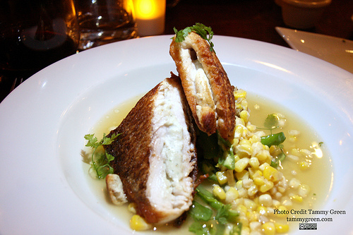 The white fish, on a bed of corn, gets two thumbs up!